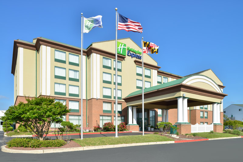 a picture of the Holiday Inn Express & Suites in Ocean City, MD showing the exterior of the building